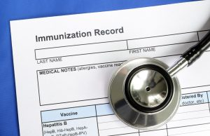 Immunization Record and a stethoscope