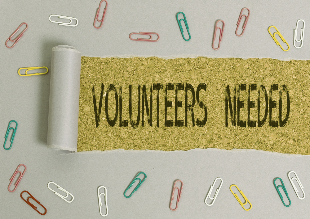 paper clips with sign volunteers needed